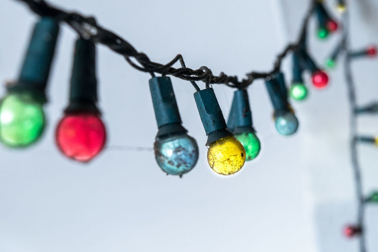 colorful light bulb hanging on string. Art Is Everywhere Close-up Colorful Light Bulb Day Focus On Foreground Hanging Indoors  Light Bulb Hanging Light Bulb Hanging From The Ceiling Against A Green Wall No People String Light Bulb