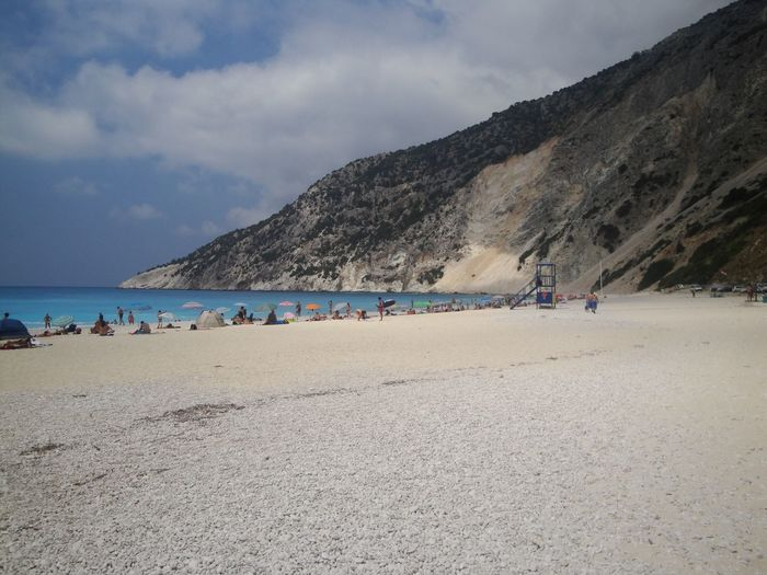 Myrtos Beach Cefalonia Sky Mountain Nature Cloud - Sky Beach Beauty In Nature Sand Large Group Of People Sea Scenics Day Outdoors Real People Vacations Landscape Water People Femalephotographerofthemonth 43GoldenMoments Taking Photos Popular Photos Travel EyeEm Best Shots