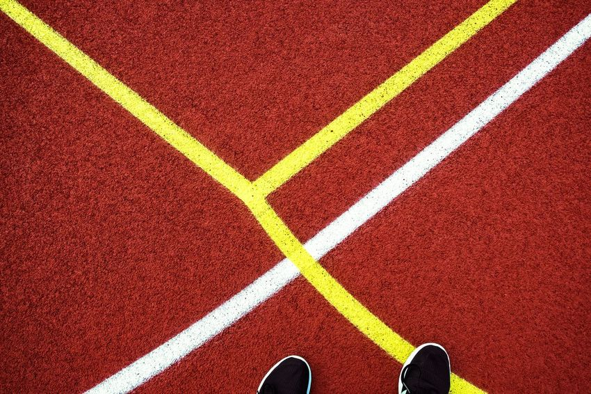 Urban Perspectives The Devil's In The Detail Sports Track Low Section Competition Finish Line  Competitive Sport Sports Race Track And Field Event Sport Running Track Starting Line Human Foot Footwear Personal Perspective Pair Things That Go Together Marking LINE Feet