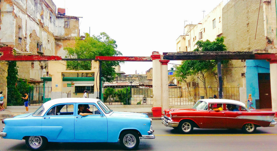 Mode Of Transportation Architecture Car Motor Vehicle Transportation Land Vehicle Building Exterior Built Structure City Retro Styled Street Day Building Road Sky Residential District Red Light Blue Old Vehicle