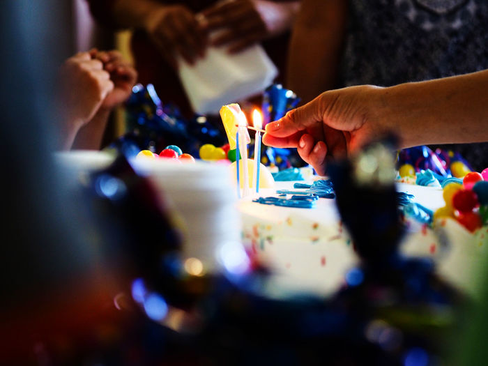 Feliz Compleaños Birthday Cake Candles Celebration Day Human Body Part Human Hand Indoors  Lifestyles Multi Colored People Real People Investing In Quality Of Life