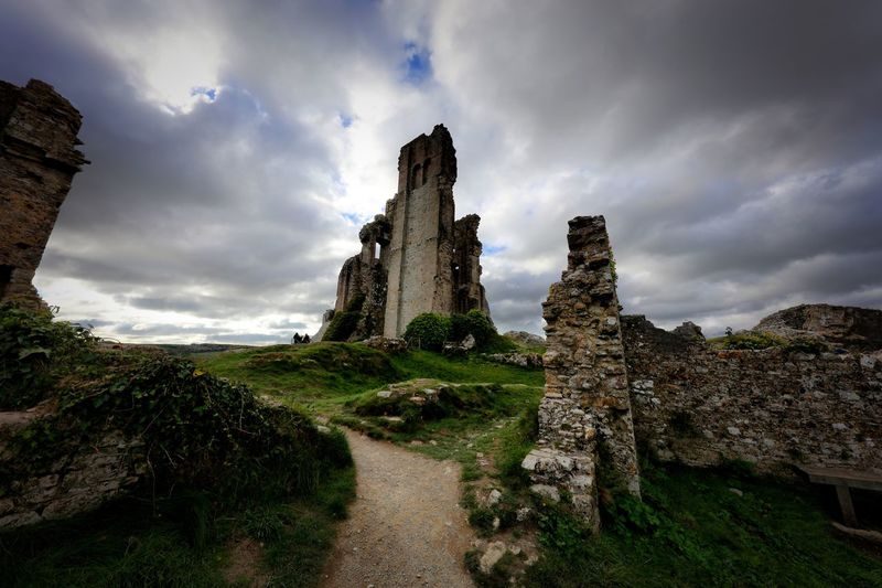 Old ruin building against cloudy sky