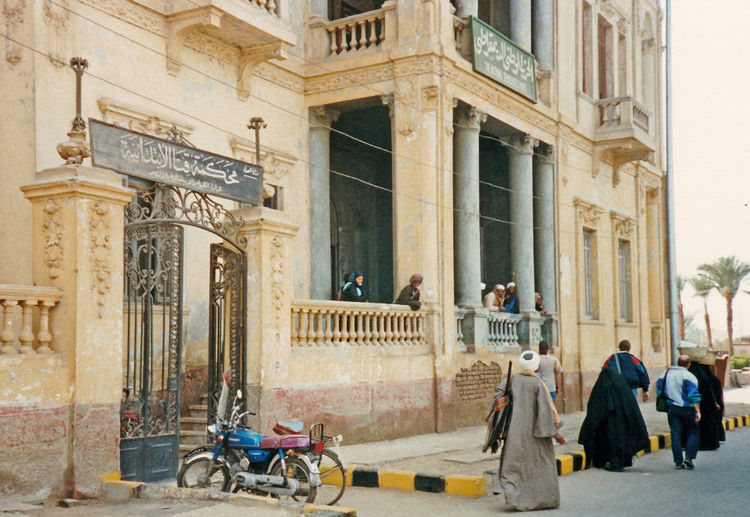 The old Lloyds Bank branch in Luxor, Egypt Kalesh Lloyds Bank Luxor, Egypt Adult Adults Only Architectural Column Architecture Building Exterior Built Structure City Day History Large Group Of People Men Motor Bike Outdoors People Tourism Travel Destinations Women