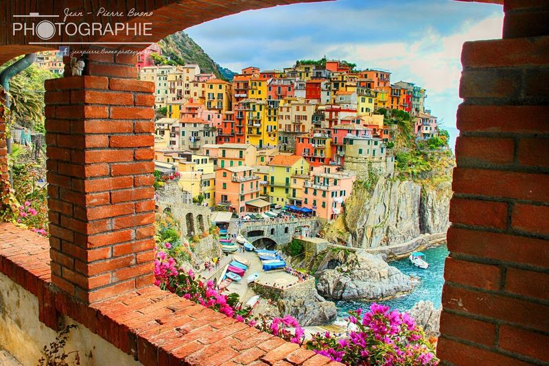 Multi Colored Graffiti Architecture Street Art No People Outdoors Day Built Structure Building Exterior City Sky cinque terre italy