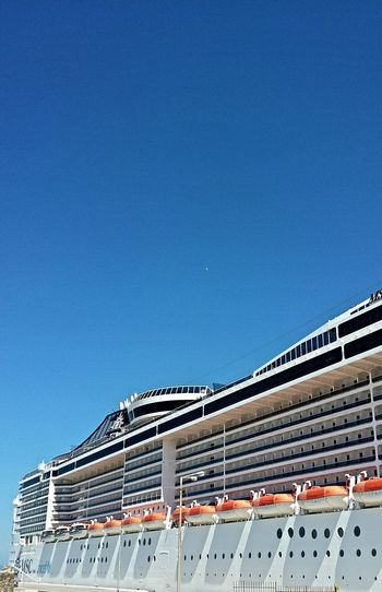 Low angle view of cruise ship against clear sky
