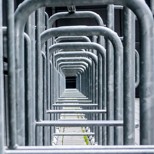 Marcweberde Metal In A Row No People Day Repetition Industry Pipe - Tube Outdoors Pattern Silver Colored Steel Architecture Pipeline Close-up Grate Absence Built Structure Focus On Foreground Railing Alloy Metal Industry