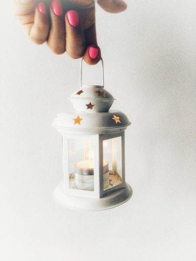 Studio Shot White Background Hanging Holding Human Hand Candle Light Candlestick Holder Candles-collection White Color Minimalism Minimalist Photography  Star Christmas Decoration Christmastime Christmas Candle Decoration Lantern Lanterns Lantern Light Christmas Lantern