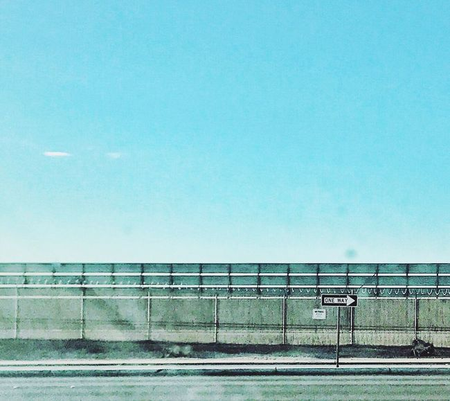 Airport runway barrier marks the terminus of a runway at Heathrowe Blue No People Day Architecture Clear Sky Built Structure Outdoors Road Sky Eye4photography  Scenics Beauty In Nature Eyeemphoto Malephotographerofthemonth Minimalism genus Ferns IPhoneography Nature The Street Photographer - 2017 EyeEm Awards