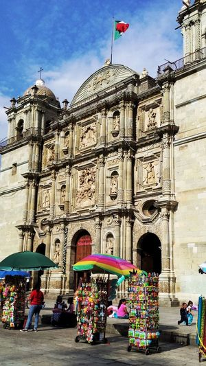 City Travel Destinations Building Exterior Built Structure Architecture Flag History Sky Outdoors Day People Adults Only Oaxaca Church Vendors Timeless Mexico