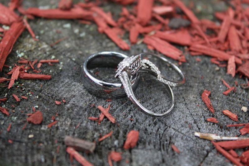 High angle view of wedding rings on wood