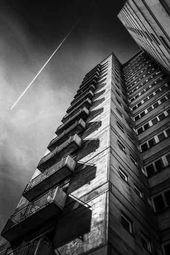 Highrise Building Against Dramatic Sky B & W Photography Black & White Photography Black And White Photography Highrise Building Ominous Beauty Urban Scene Vertical Shot Apartment Buildings Urban Architecture Urbanity Berlin Building Exterior Built Structure Architecture Sky Building City Vapor Trail No People Tall - High Pattern Sunlight Architecture Residential District Modern