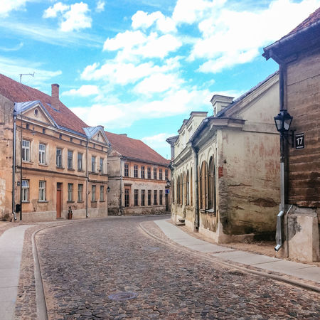 Historic buildings on Baznica Iela, Kuldiga. Latvia Architecture Building Building Exterior Buildings Built Structure Cobblestone Culture Façade Historic History Houses Kuldiga Latvia Old Buildings Outdoors Residential Structure Road Spirituality Street Summer Summertime
