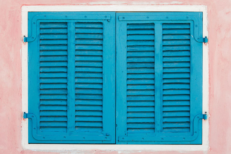 Closed blue window of building