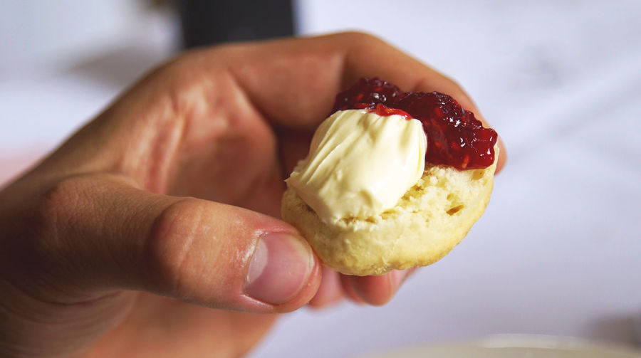 Cropped Hand Holding Scone