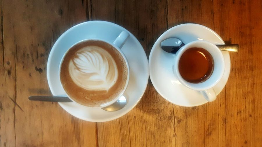 Coffee - Drink Drink Coffee Cup Food And Drink Table High Angle View Cappuccino Still Life Latte Frothy Drink Refreshment Froth Art Directly Above Heart Shape No People Wood - Material Indoors  Saucer Cafe Breakfast