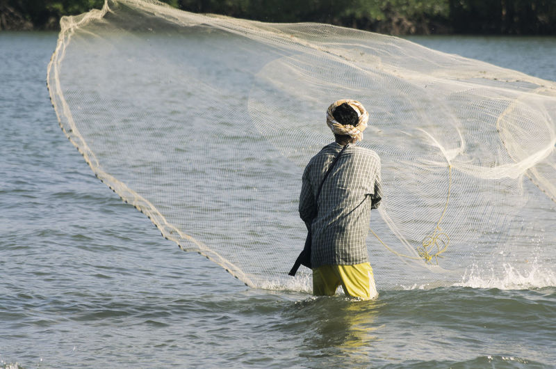 Net fishing in croc waters. Andaman Islands Andaman Sea Beware Crocodiles Delta Fishing Motion Nature Net People Of The Oceans Rippled Water Waterfront