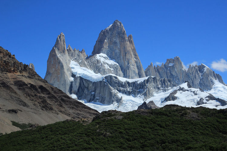 Fitz Roy mountain close up view. Fitz Roy is a mountain located near El Chalten Fitzroy Beauty In Nature Blue Clear Sky Climbing Wall Cold Temperature Day Environment Formation Height High Landscape Mountain Mountain Peak Mountain Range Nature No People Patagonia Argentina Range Rock Scenery Scenics - Nature Sky Snow Wilderness