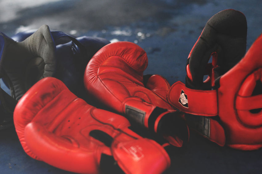 Red Boxing Gloves and Headgear on Boxing Ring. Athlete Athletics Boxe Boxer Boxing Boxing Gloves Boxing Life Boxing Ring Boxing♥ Competition Fitness Gloves And Helmets Glowing Headgear Kick Muscular Red Ring Sport Training