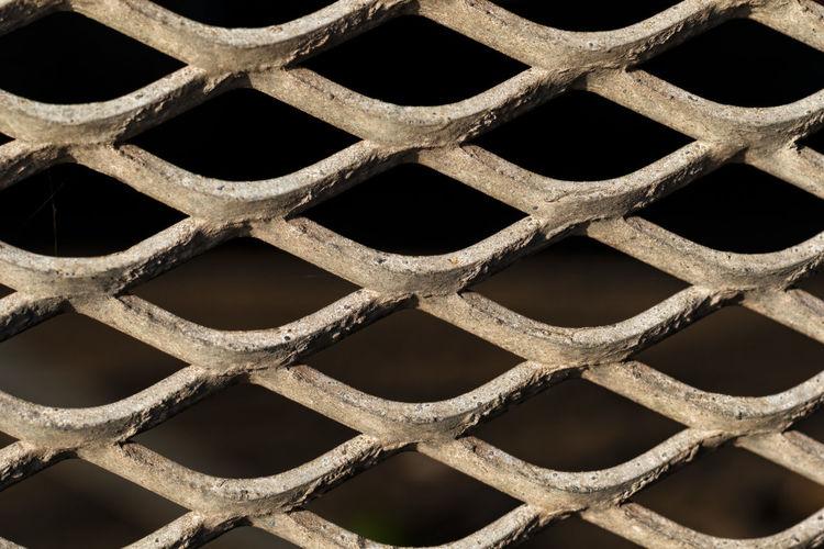 Detail shot of metal fence - mesh - grid