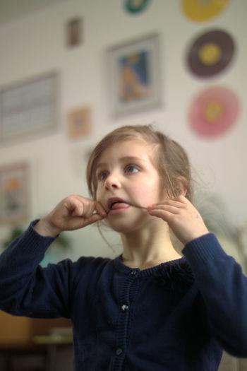 Cute Girl Biting Hair At Home
