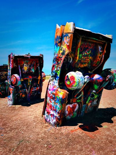 Cadillac Ranch Cars Cadillac Ranch Multi Colored Sky Nature Sunlight Graffiti No People Creativity Art And Craft Outdoors Built Structure Abandoned
