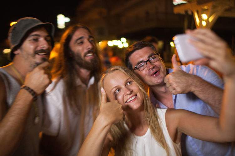 Caucasian Cell Cellphone Couple Friend Friendship Group Horizontal Man Night Outdoor Party People Photo Photography Selfie Shot Smartphone Thumbs-up Woman
