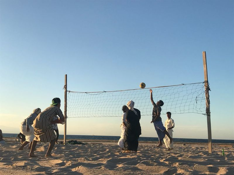 Beach Beach Volleyball Clear Sky Net - Sports Equipment Sand Volleyball - Sport Sport Nature Outdoors Sea People Men Playing Sky Full Length Togetherness Friendship Standing Real People Day