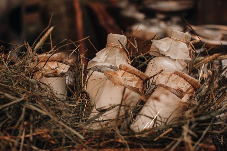 Milk bottle mockups on the hay. autumn farm fair market. rustic style.  thanksgiving season