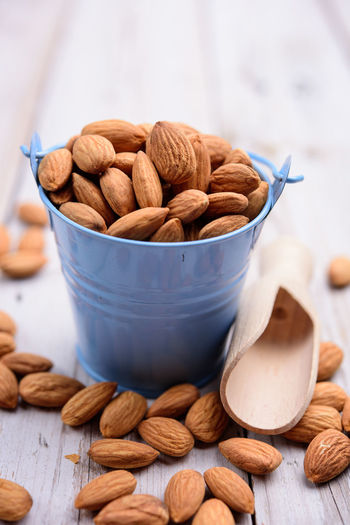 Food And Drink Nut Food Nut - Food Bowl Still Life Freshness Large Group Of Objects Close-up Wellbeing Healthy Eating Table Indoors  Almond Brown Wood - Material No People Focus On Foreground Abundance Container Snack