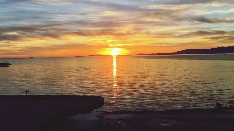 Sunset Water Sea Beauty In Nature Orange Color Nature Sky Scenics Tranquility Sun Idyllic Horizon Over Water Reflection Tranquil Scene Cloud - Sky No People Outdoors Shiny Beach Day