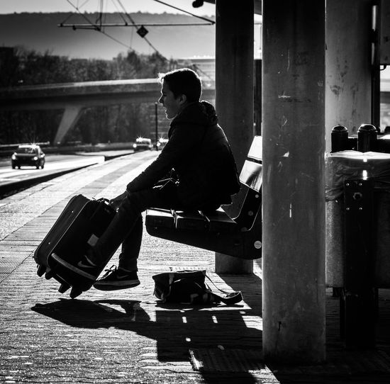 Sitting Mode Of Transportation Transportation Sunlight Waiting For A Train Waiting With Patient Suitcase Bnw_captures Backlight Tramstation Subway Platform Train Platform High Contrast Rheinaue Outdoors Side View Patiently Waiting The Week on EyeEm
