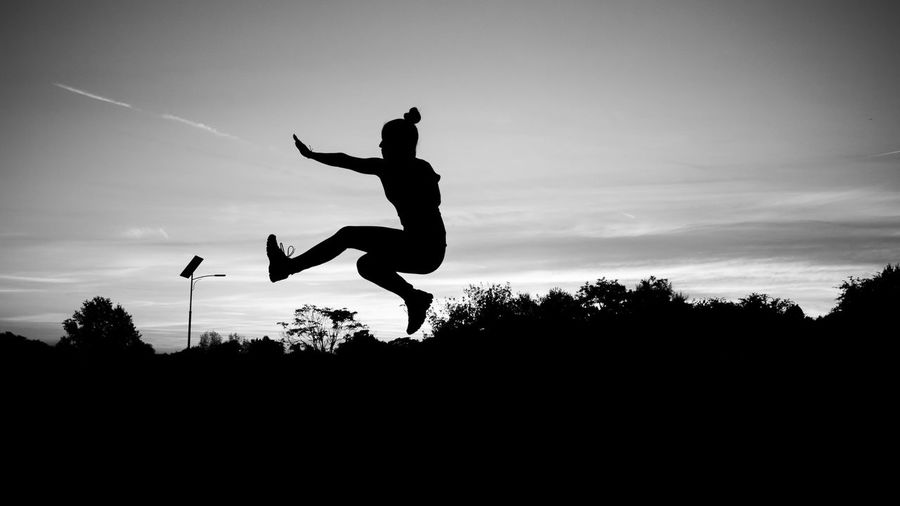 Jump Silhouette Sky Sunset Dusk Low Angle View Tree Enjoyment Scenics Tranquil Scene Mid-air Tranquility Cloud - Sky Outline Nature Outdoors Fun Beauty In Nature Growth Non-urban Scene Jump Jumpshot Blackandwhite Bws_worldwide BW Collection BW_photography