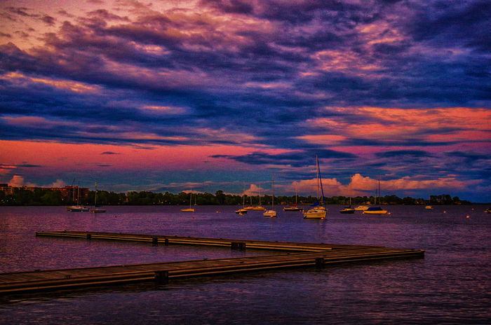 Sun setting over the venture sailing club in Pointe-Claire, Quebec Boating Sunset_collection Beauty In Nature Boats Cloud - Sky Dock Harbor Nautical Vessel No People Outdoors Scenics Sea Sky Sunset Water Lost In The Landscape