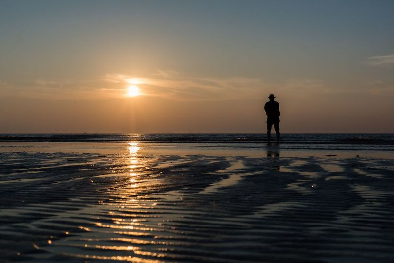 the old man and the sea Northsea Sonnenuntergang Sunset Rømøstrand Rømø Denmark Water Sunset Sky Silhouette Sea Beauty In Nature Standing Men Tranquil Scene Beach Horizon Tranquility One Person Nature Horizon Over Water Reflection Scenics - Nature
