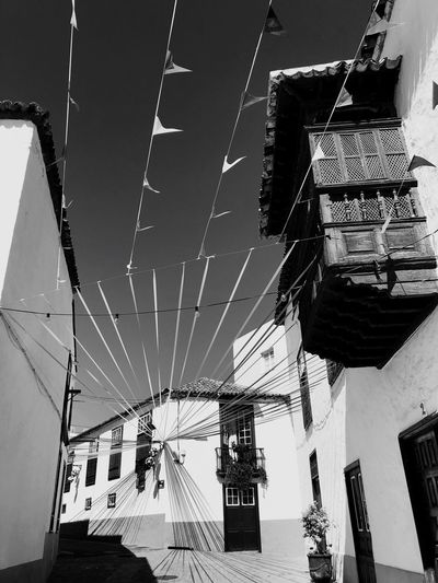 San Juan de la Rambla en fiesta Low Angle View Built Structure Architecture Decoration Building Exterior No People Building Lighting Equipment Sunlight Text Communication Art And Craft Day Outdoors Wall - Building Feature Sky Hanging Shadow Clear Sky Nature