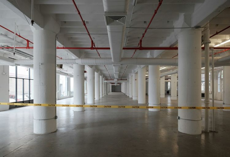 Cordon tape by columns in building basement