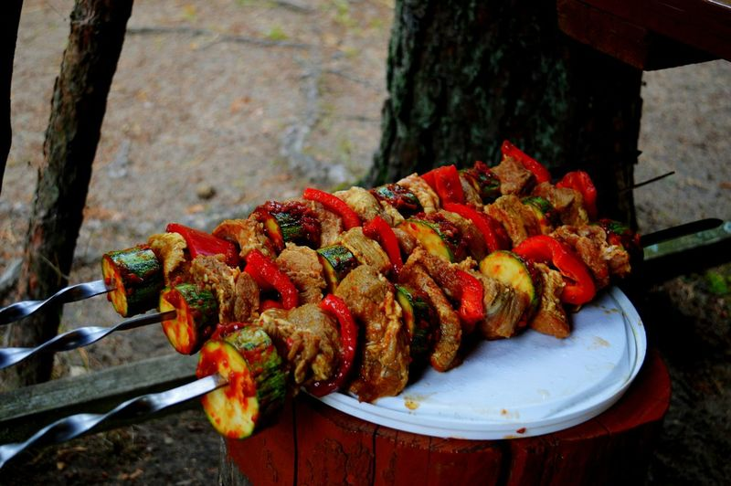 High angle view of marinated skewers on table in yard