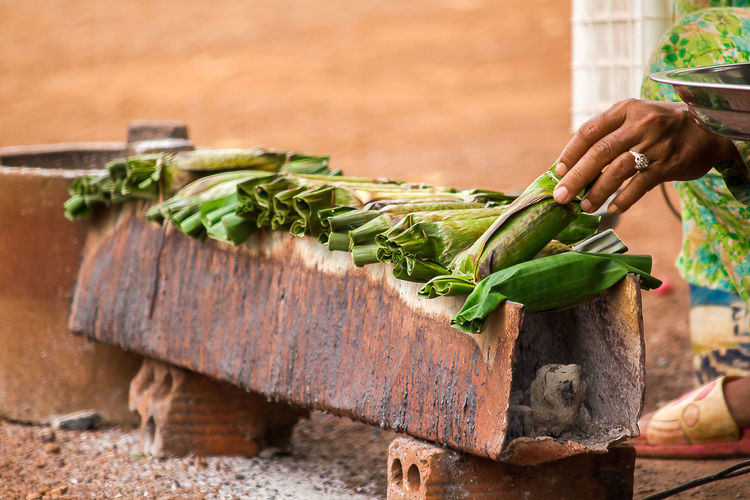 Sticky rice toast on the stove Food Food And Drink Freshness Day Green Color Sticky Rice Toast Sticky Rice Sticky Rice Dessert Agriculture Outdoors Farmer Focus On Foreground Holding Plant Part Hand Human Body Part Leaf Nature Human Hand Wood - Material Healthy Eating One Person Wellbeing Vegetable