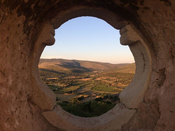 Scenic view of landscape seen through archway