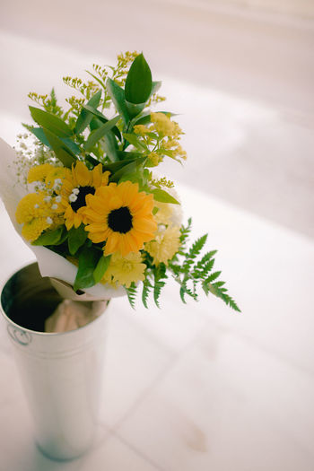 High angle view of white flower vase on table