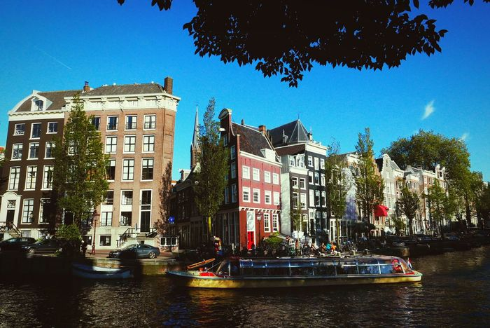 Love Amsterdam! Amsterdam Canal Historical Building Cityscapes On My Way Home Canal Boat Being A Tourist Walking Around The City  Enjoying The Sun Old Buildings EyeEm X Google - Your Amsterdam