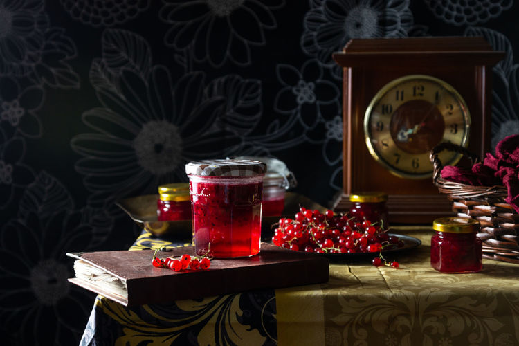 Container darkness and light Decoration Fire Floral Pattern Food Food And Drink Freshness Glass Glass Jars Illuminated Indoors  Jam Nature No People Red Currant Still Life Table Tablecloth
