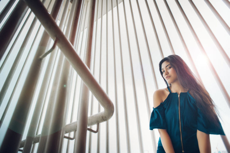 Adult Adults Only Beautiful Woman Beauty Black Hair Curtain Day Indoors  Low Angle View One Person One Woman Only People Smiling Standing The Portraitist - 2017 EyeEm Awards Young Adult Young Women BYOPaper!