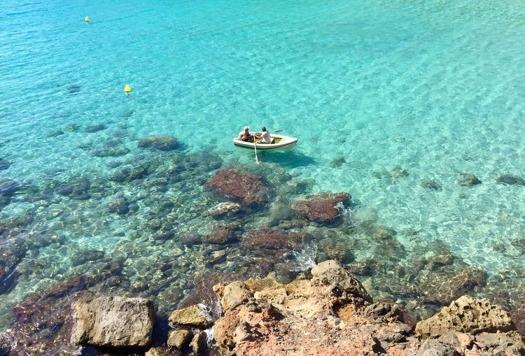 High Angle View Of Two People Kayaking In Sea