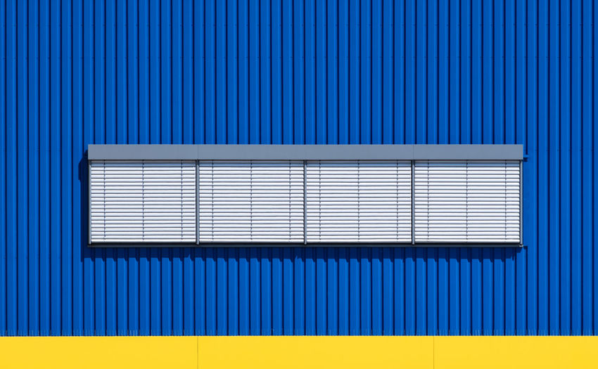Blinds Architectural Detail Architectural Feature Architecture Backgrounds Berlinmalism Blue Built Structure Closed Corrugated Corrugated Iron Fujix_berlin Industry Iron Metal Minimal Minimalism No People Pattern Ralfpollack_fotografie Striped Technology Textured  Wall - Building Feature The Architect - 2018 EyeEm Awards