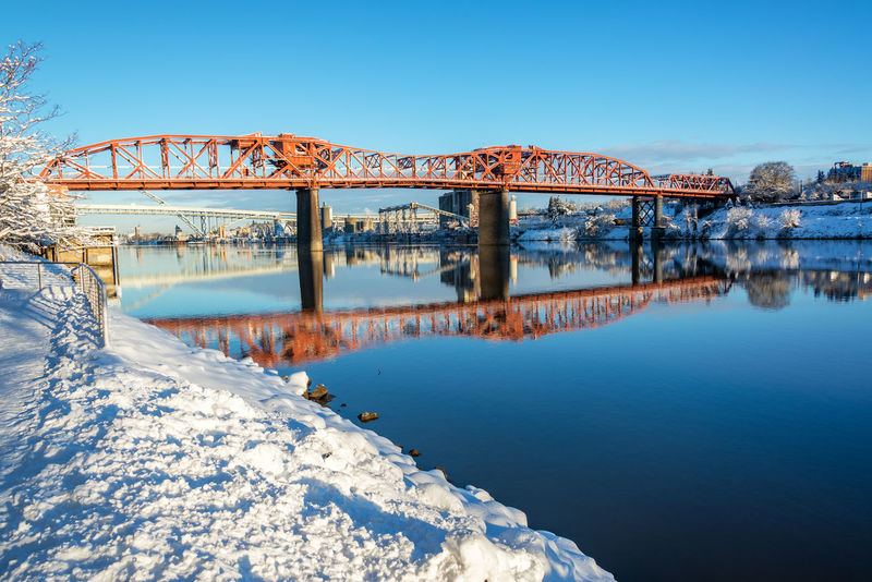 Broadway Bridge reflected in the Willamette River on a beautiful snowy day in Portland, Oregon Architecture Bridges Broadway Downtown Ice Mirror Oregon Pacific Portland Reflection Tree Trees Willamette River  Winter Bridge Cold Colorful Icy Northwest Old River Snow Town Waterfront White