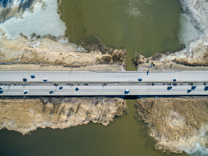Directly Above Shot Of Vehicles On Bridge Over Lake