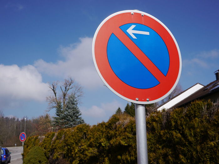 Trafficsign in south Germany Allgäu Guiding Traffic Circle Communication Day Guidance Guide Low Angle View Nature No People Outdoors Road Sign Sky Traffic Sign Tree