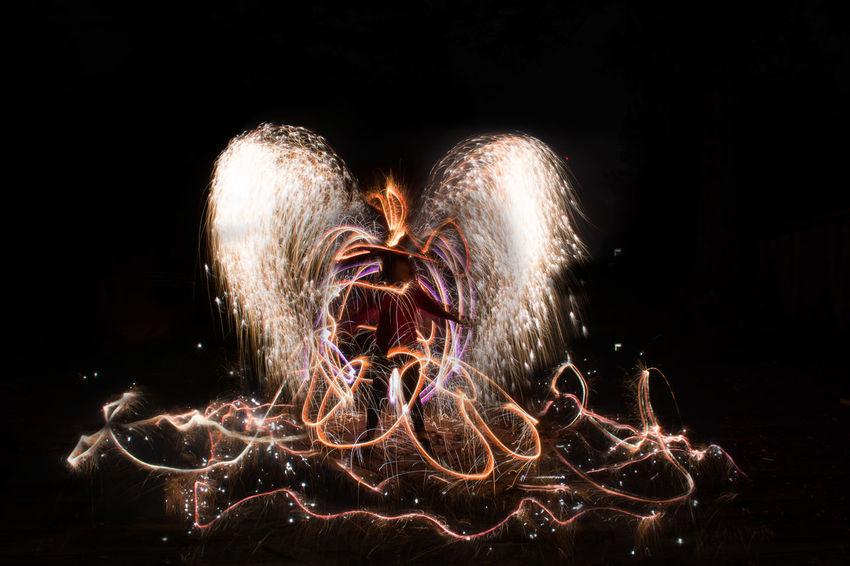 Arts Culture And Entertainment Celebration Glowing Illuminated Light Long Exposure Motion Night