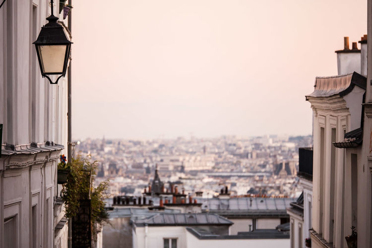 Architecture Building Exterior Built Structure Chimneys City Cityscape Cityscape Clear Sky Day Dusk Hill Houses Monmartre No People Outdoors Paris Rooftops Sight Sky Street Lamp Sunset Top View Vista Place Of Heart